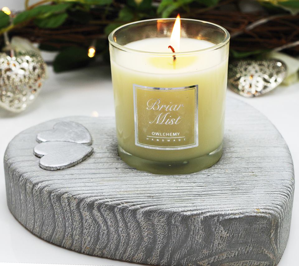Our Briar Mist candle in a silver candle holder