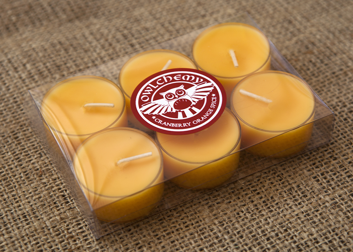A box of our Cranberry Orange Spice Tea Lights on a hessian carpet.