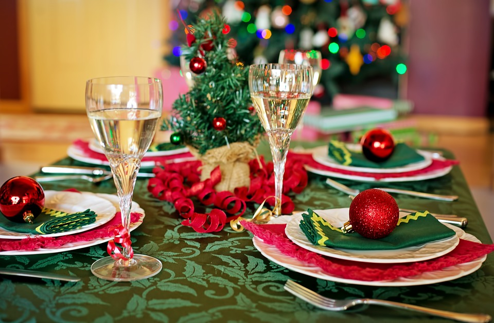 A Christmas table decorated with red glittery baubles.