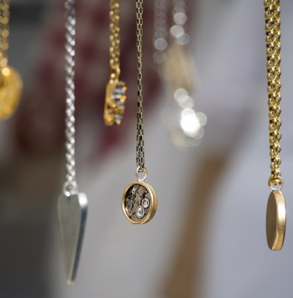 A selection of personalised necklaces in both gold and silver.