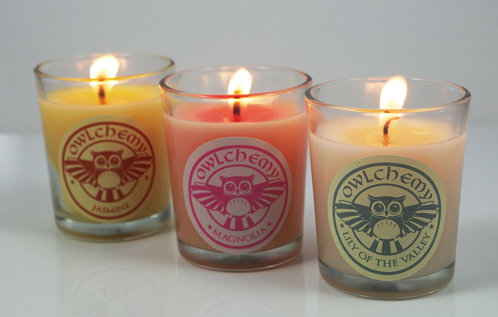 Our luxury set of three summer-scented candles lit on a summer's evening.